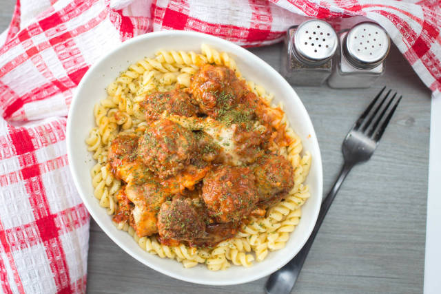 meatballs with Tomato Sauce and Cheese on Pasta Top View