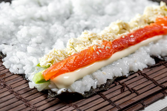 Close-up filling for sushi rolls on dried seaweed nori