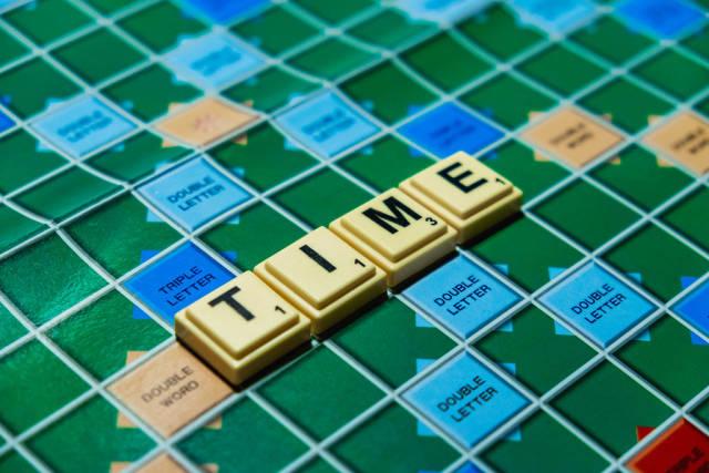 "Macro shot of ""Time"" word on scrabble board"