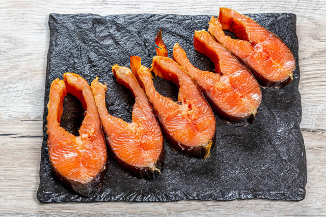 Top view of steak of smoked salmon