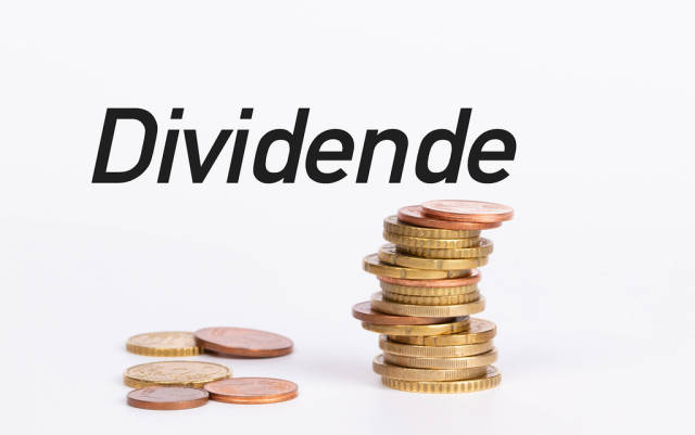 Stack of coins with text Dividende