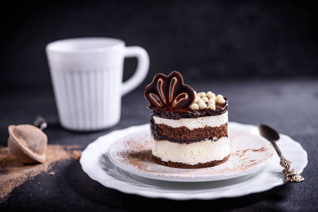 Chocolate cake served with cup of coffee