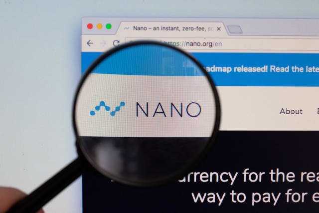 Nano logo on a computer screen with a magnifying glass