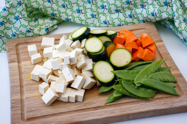 Vegetables and Tofu on a Cutiing Board