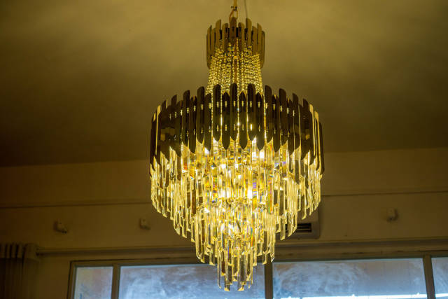 Circular Crystal Chandelier with Bright Light Bulbs in a Coffee Shop in Ho Chi Minh City, Vietnam