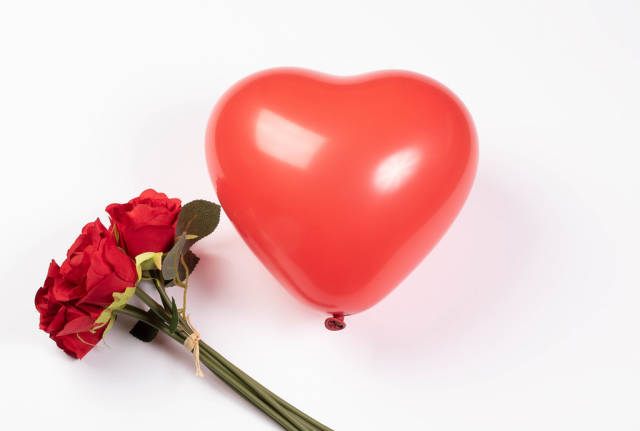 Red heart shaped balloon with flowers