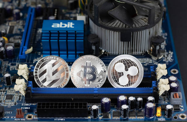 Litecoin, Bitcoin and Ripple on motherboard