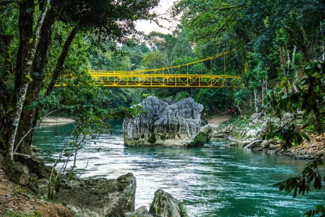 A Yellow Bridge Overpassing the Cahabon River