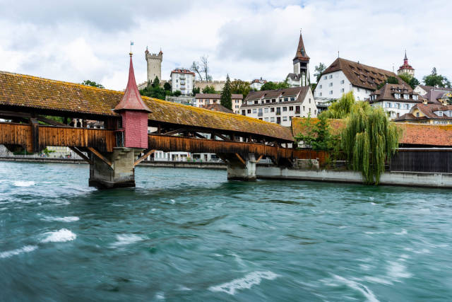 Close up a famous Chapel Bridge with the city of Lucern in the background