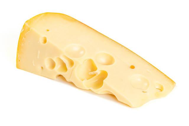 Maasdam cheese on white background