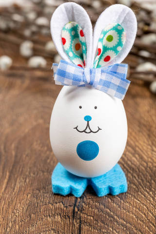 Easter background with a decorated egg