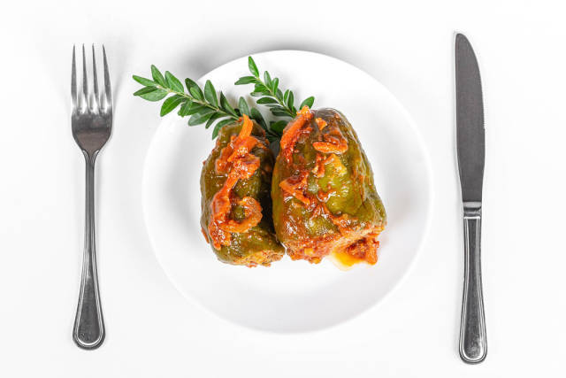 Top view, stuffed sweet peppers with tomato sauce