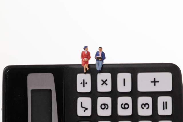 Couple sitting on calculator