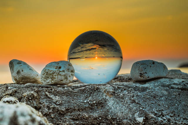 Sunset reflection in a glass ball