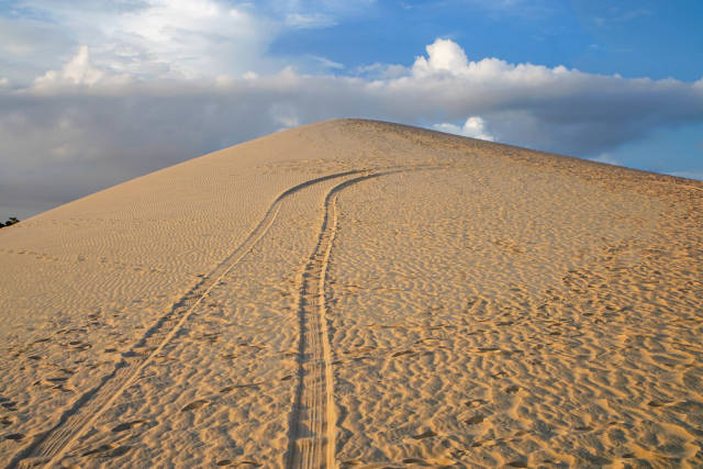 Mountain in the White Sand Dunes with a Cloudy Sky in Mui Ne