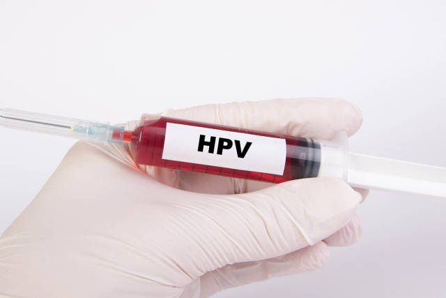Injection needle with HPV text