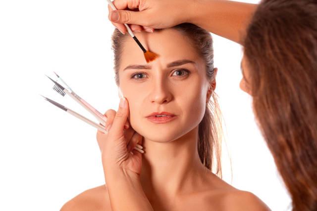 Makeup artist makes a girls makeup