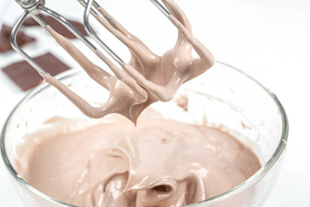 Close-up, mixer whisk with chocolate ice cream