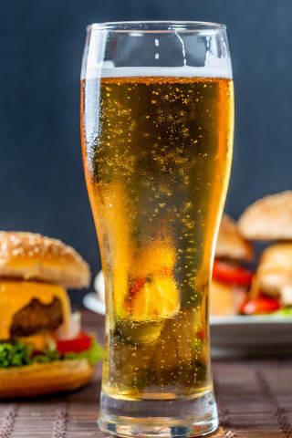 A glass of cold beer and burgers