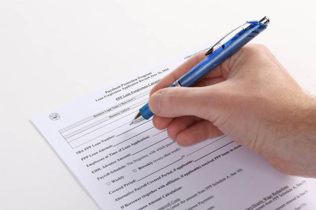 Man filling out Paycheck Protection Program Application