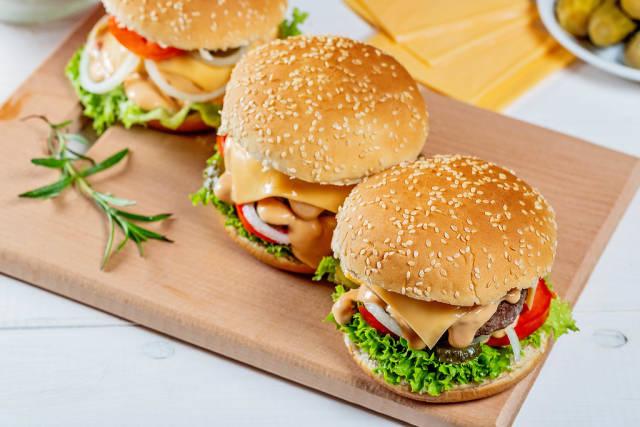 Three hamburgers on the kitchen Board