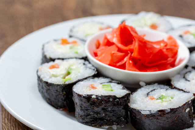 Close-up of homemade sushi rolls with pickled ginger