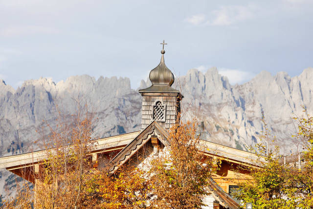 Chapel at Brenneralm, Kufstein, Austria. Wilder Kaiser mountains on background