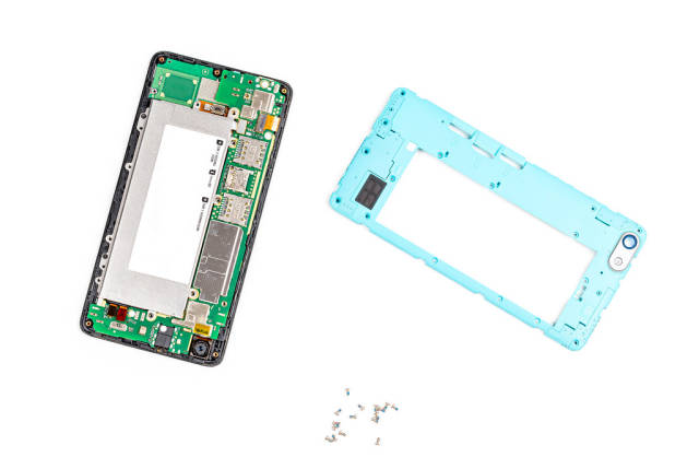 Disassembled smartphone with cover and screws on a white background