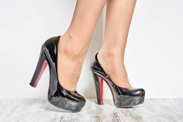 Young businesswoman wearing trendy Louboutin shoes