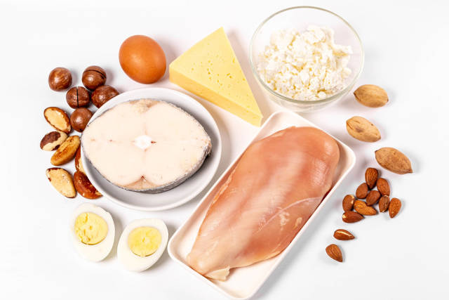 Fish, meat, eggs, dairy products and nuts - protein diet concept