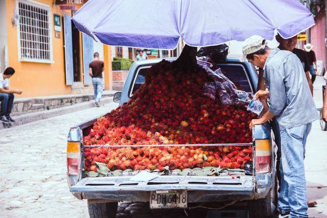 A Man Selling Rambutans