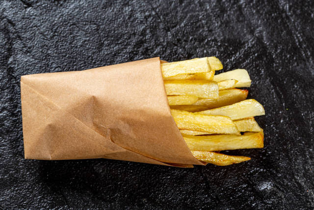 Top view French fries on black background