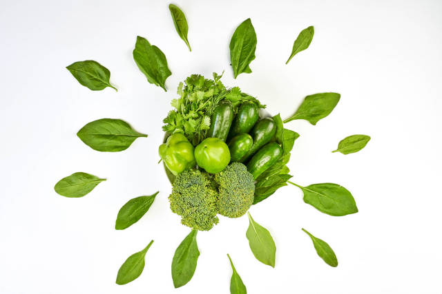 Plate of fresh green vegetables for healthy dieting