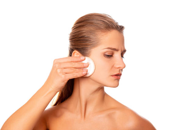 Beautiful girl takes care of her skin