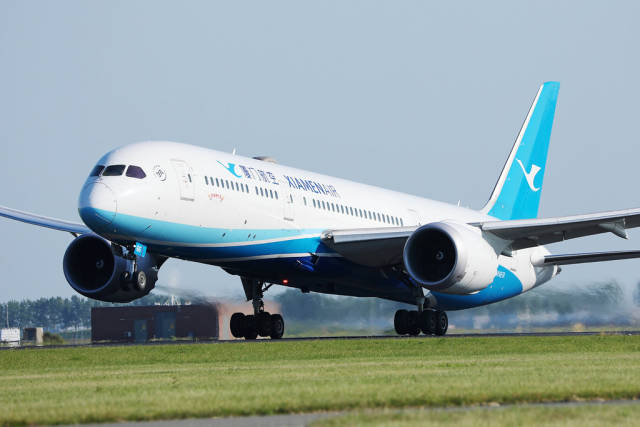 Xiamen Air taking off from Amsterdam Schiphol Airport AMS