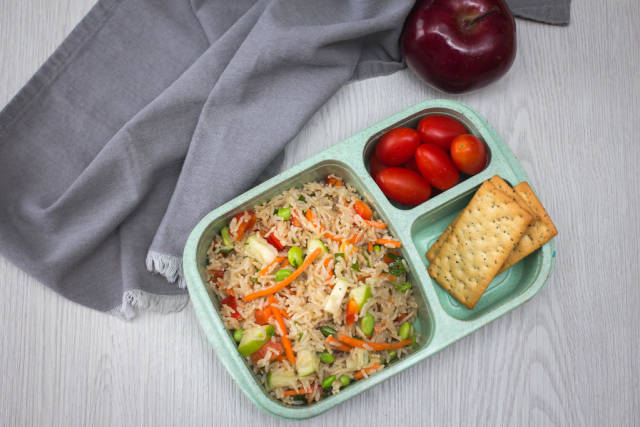 Rice Salad wiht Tomatoe and Cracker in a Bento Box Top View