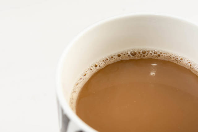Cup of Coffee in closeup with copy space