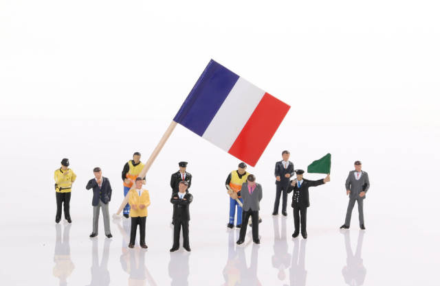 Miniature people with flag of France