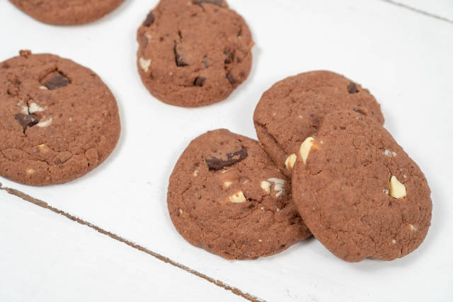 Round Chocolate Cookies on the wooden table