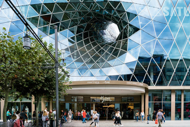 Modern parametric building with a hollow in glass facade of My Zeil mall