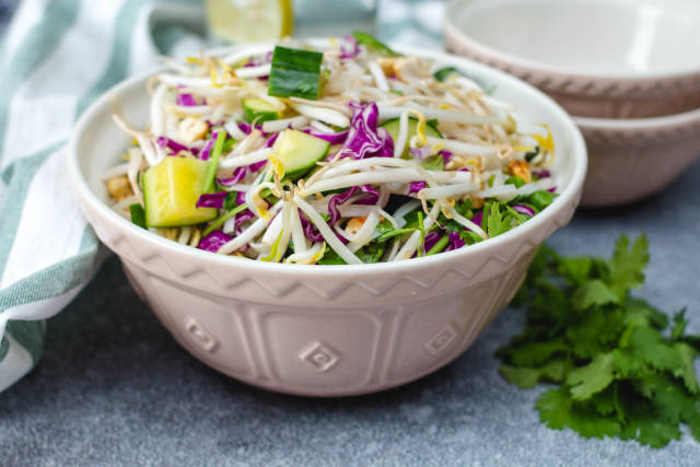 Sprout Asian Salad with Cucumber and fresh herb in a bowl