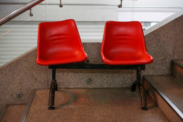 Red Vintage Plastic Seats on Stairs