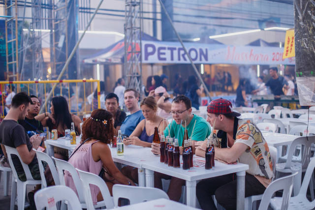 Foreigners eating outside a food stall, Bacolod City