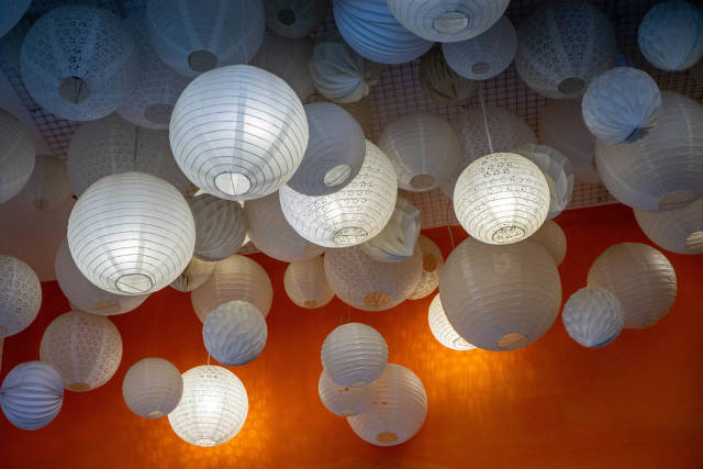Different Shaped Round Paper Ceiling Lamps in a Cafe