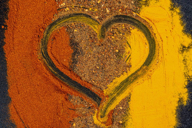 Dry spice mix with heart in the middle, top view