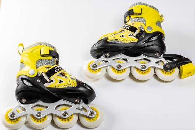 Pair of roller skates on white
