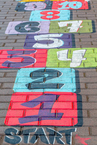 Multi-colored drawing on the pavement with numbers. Childrens classic game