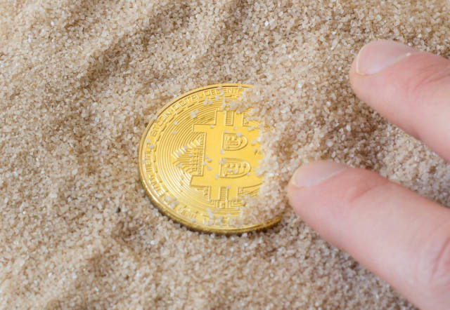 Bitcon in sand