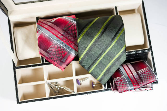 Ties, cufflinks, and pocket square in box organizer