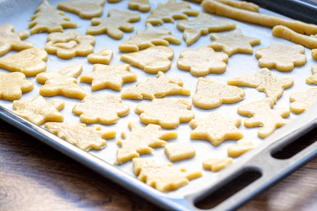 On a baking sheet raw cookies before sending it in the oven